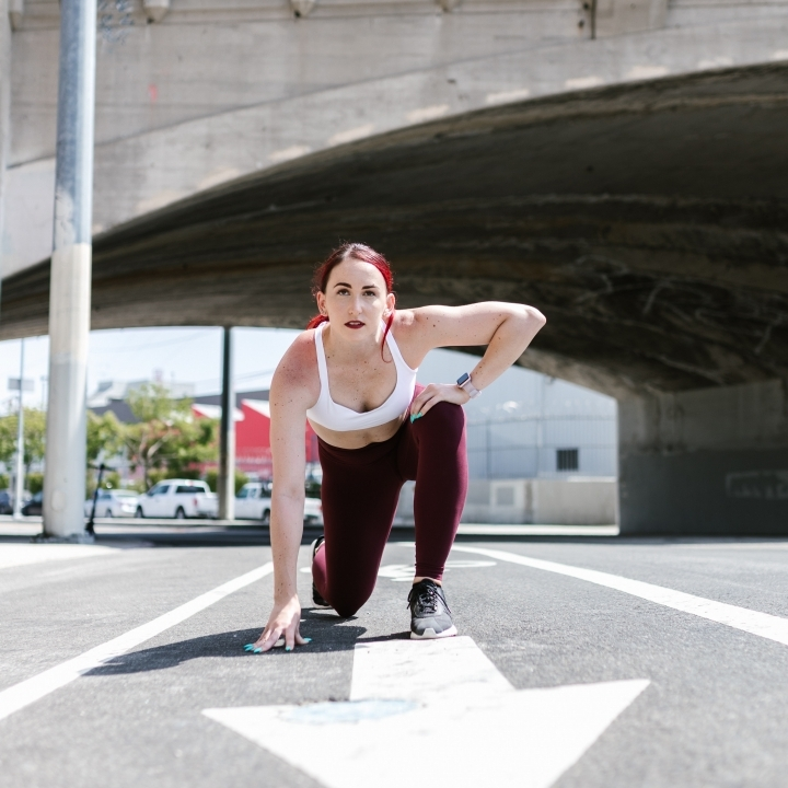 Woman prepares to go for a run wearing a smartwatch